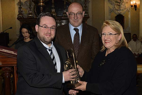 The President of Malta awarding the Youth of the Year Trophy to James Borg Cumbo.  Dr George Hyzler LL.D, Chairman of the independent Selection Board is In the background . Photo: Robert Soler
